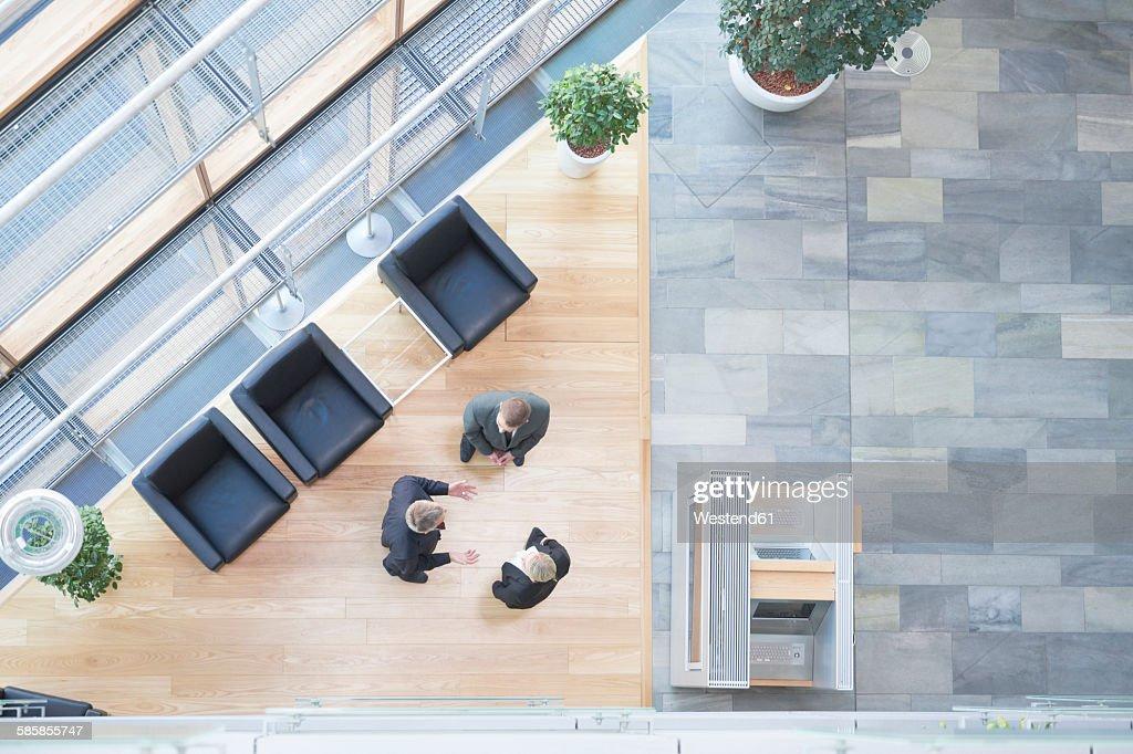 Three business people communicating