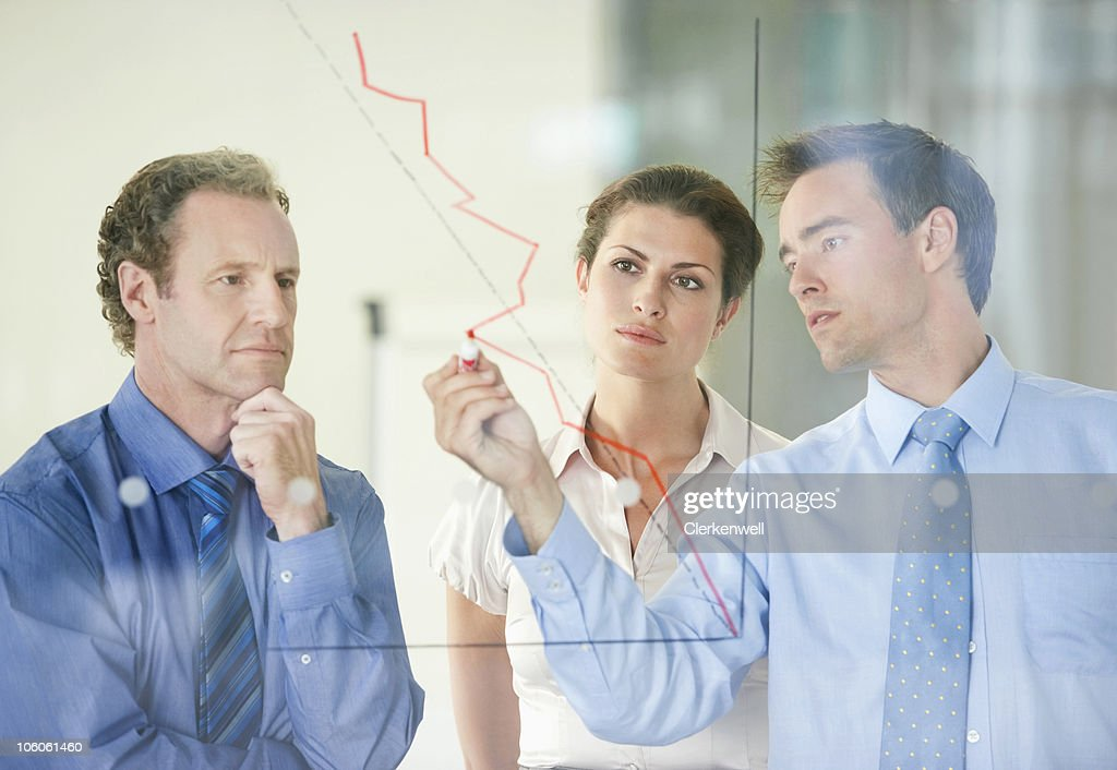 Three business people having a meeting on business development : Stock Photo