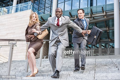 Three Business People Racing to See Who Will be First