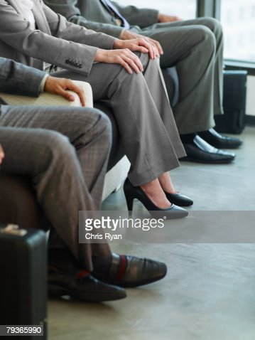 Three Business Peoples Legs In An Office Lobby Stock Photo