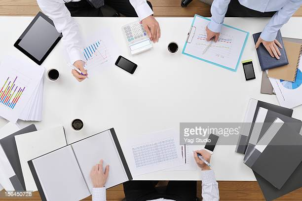 Three businessmen meeting