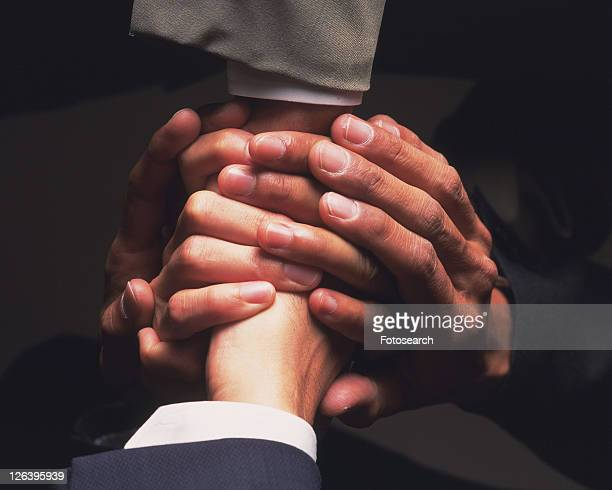 Three businessmen shaking hands, High Angle View, Close Up