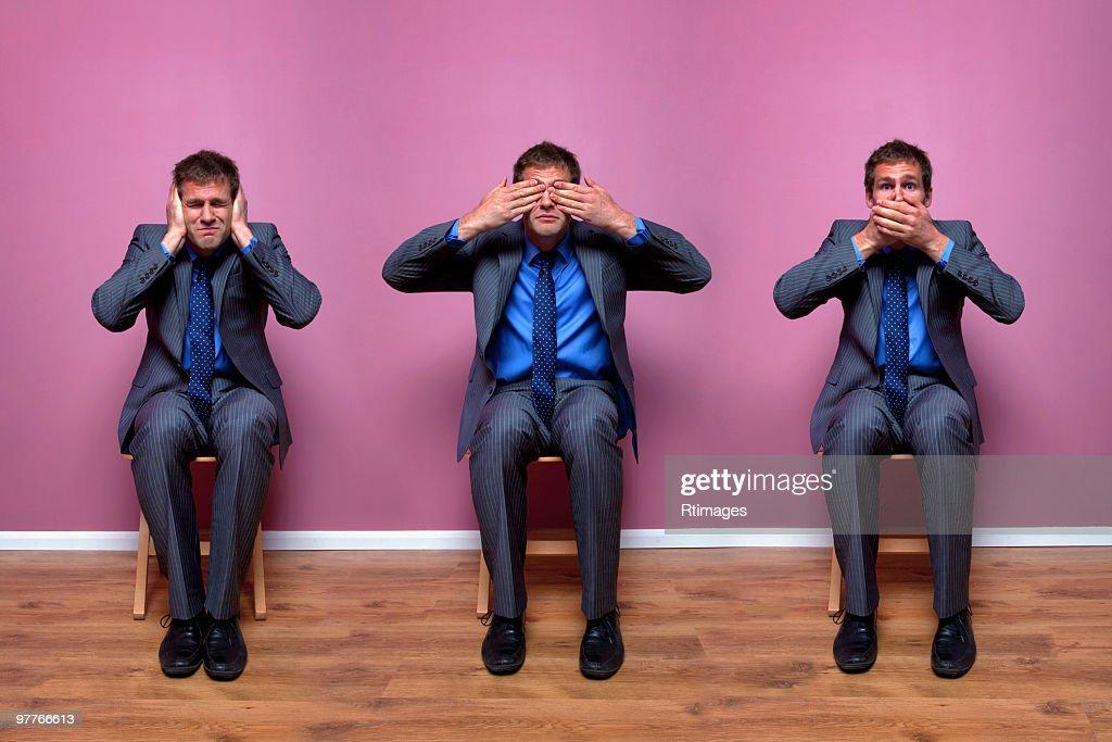 Three businessmen sitting in chairs