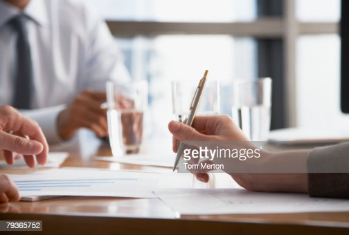 Three businesspeople at a boardroom table : Stock Photo