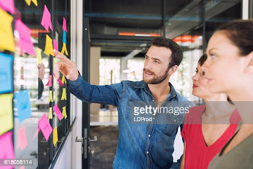 Three businesspeople discussing and planning concept : Foto de stock