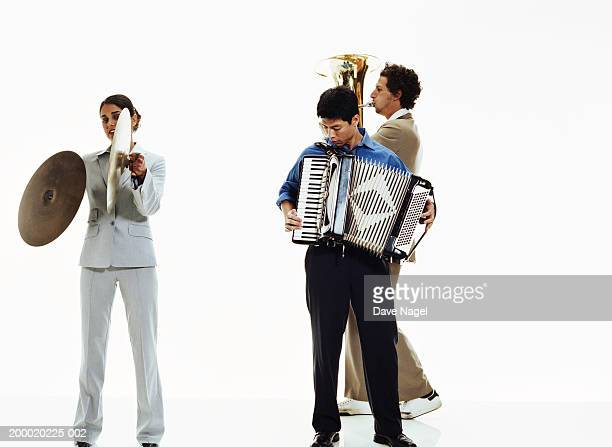 Three businesspeople playing musical instruments