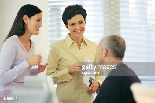 Three businesspeople talking : Stock Photo