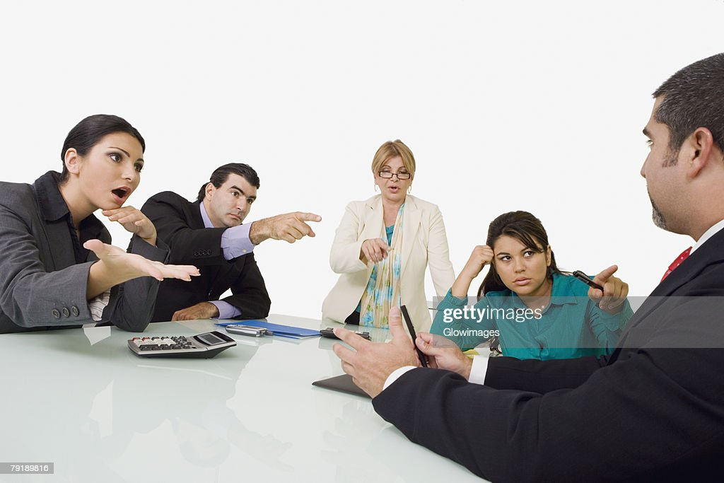 Three businesswomen and a businessman blaming another businessman : Foto de stock