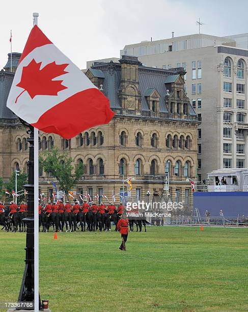CONTENT] Three Canadian icons the RCMP Musical Ride the Canadian Flag and a Tim Horton's coffee cup all on Parliament hill on Canada Day