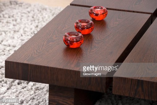 Three candles on a table : Foto de stock