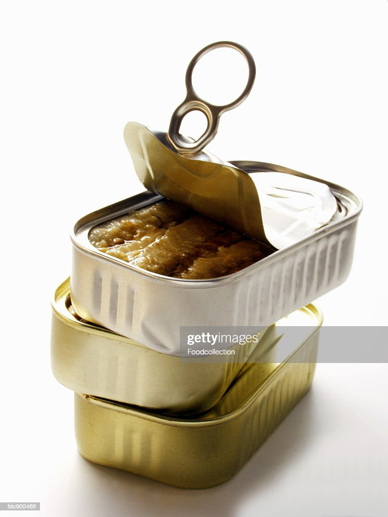 Three Cans of Sardines; One Opened