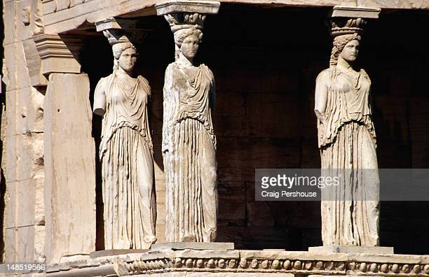 Three Caryatids supporting southern portico of Erechtheion at Acropolis.