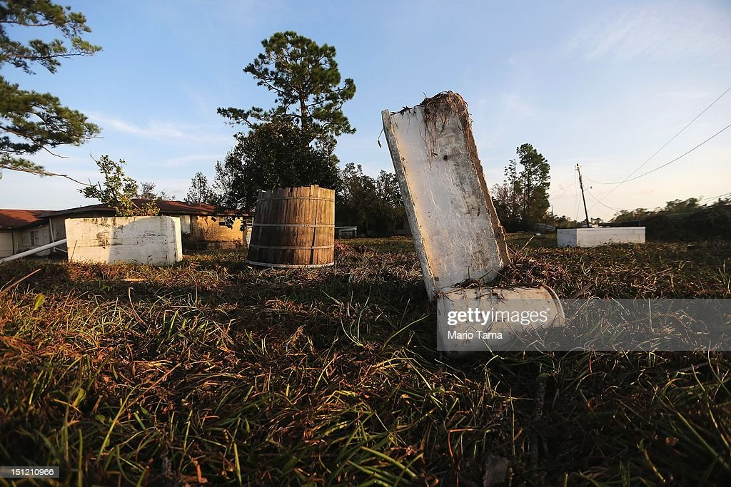 Three caskets sit in the mud resulting from Hurricane Isaac flooding in Plaquemines Parish on September 3, 2012 in Braithwaite, Louisiana. Damage totals from the storm could top USD 2 billion and more than 125,000 customers are still without power six days after the storm made landfall.