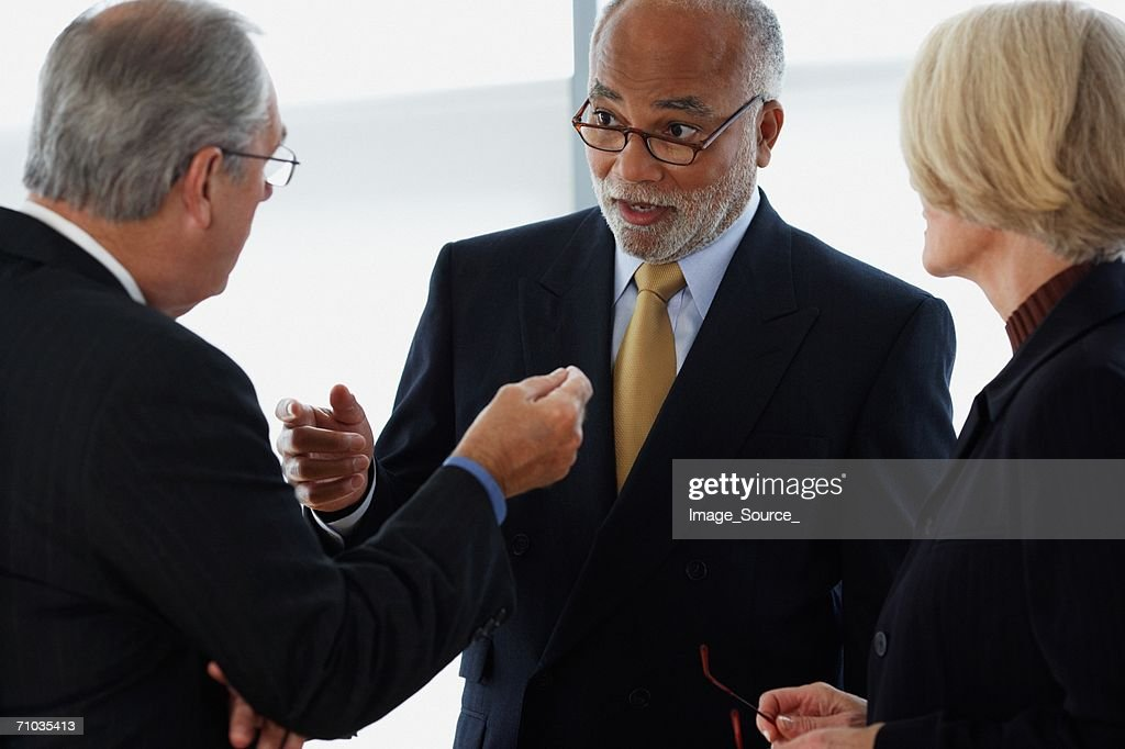 Three ceos having an argument : Stock Photo