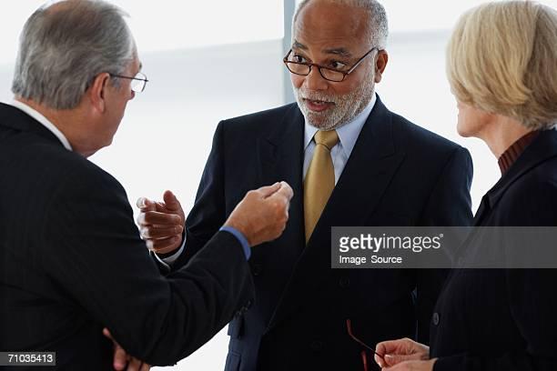 Three ceos having an argument