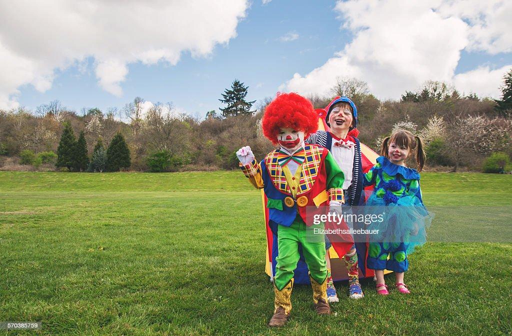 Three children dressed as clowns