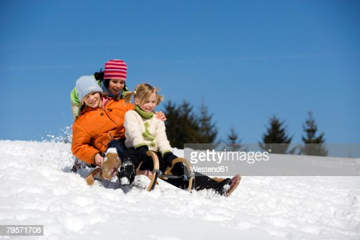 Three children on sledge : Foto stock