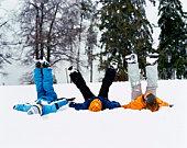 Three children playing in snow