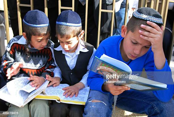 Three Children reading the Bible.