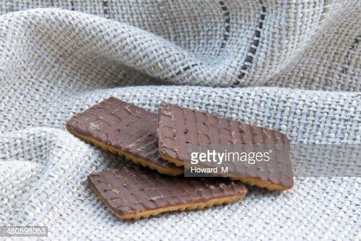 Three chocolate biscuits : Stock Photo