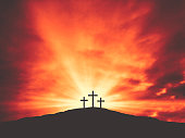 Three Christian Good Friday Crosses Silhouette on Hill of Calvary with Sun and Clouds in Sky Background - Crucifixion of Jesus Christ