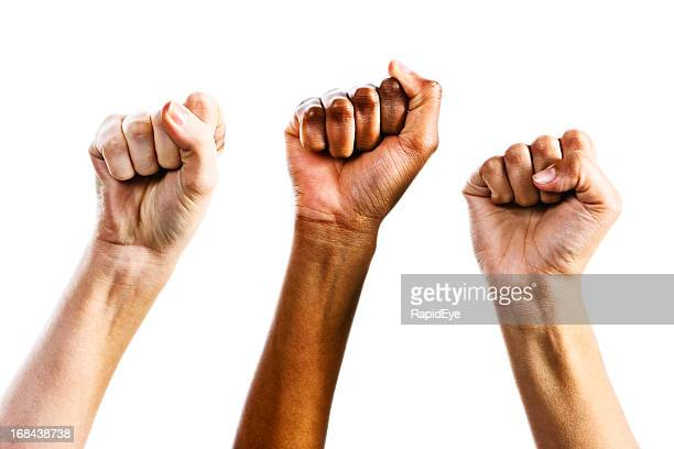 Three clenched female fists triumphantly supporting women's rights