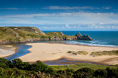 Three Cliffs Bay on the Gower Peninsular, West Glamorgan, Wales, UK, which is a popular Welsh coastline attraction of outstanding beauty