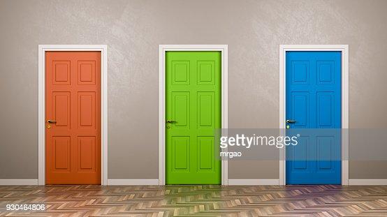Three Closed Doors in the Room : Stock Photo