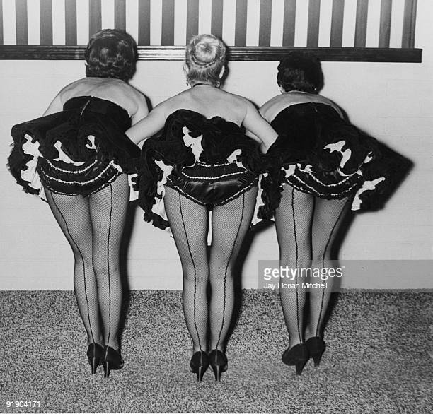Three cocktail waitresses at the Club Black Magic circa 1950
