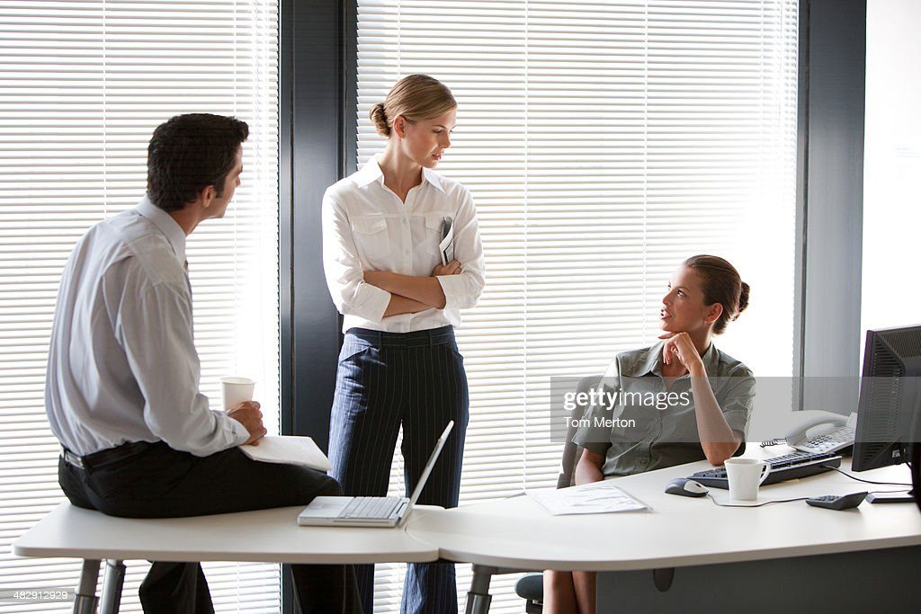 Three colleagues meeting : Stock Photo