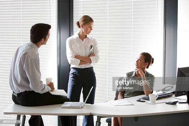 Three colleagues meeting