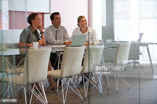 Three colleagues meeting with using laptop