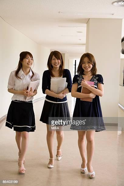 Three college students walking