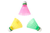 Three color shuttlecocks for playing badminton on the white background