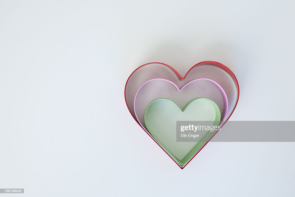 Three colored cookie cutter hearts : Stock Photo