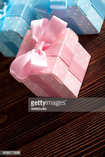 Three colored gift boxes on wooden background : Stockfoto