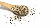 Three colour quinoa on wooden spoon isolated on white background.organic superfood.raw seeds