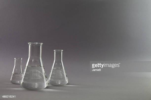 Three conical glass flasks