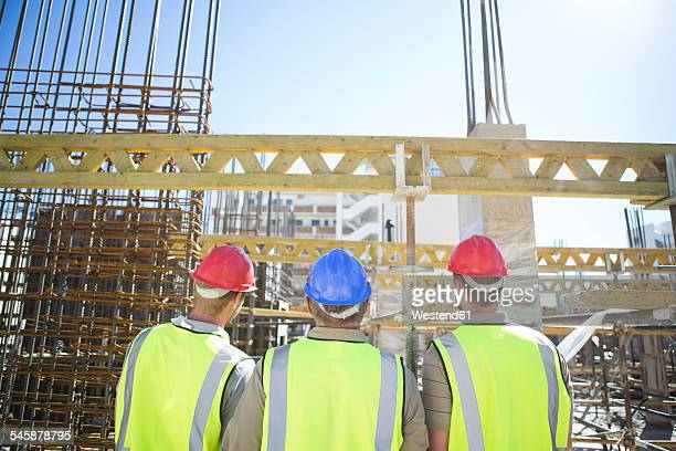 Three construction workers in construction site