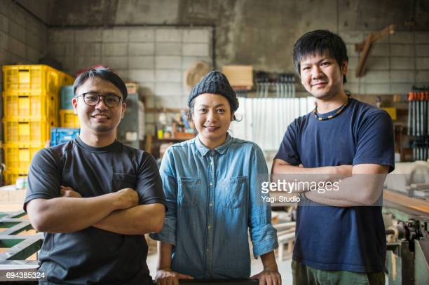 Three craftsperson working in studio