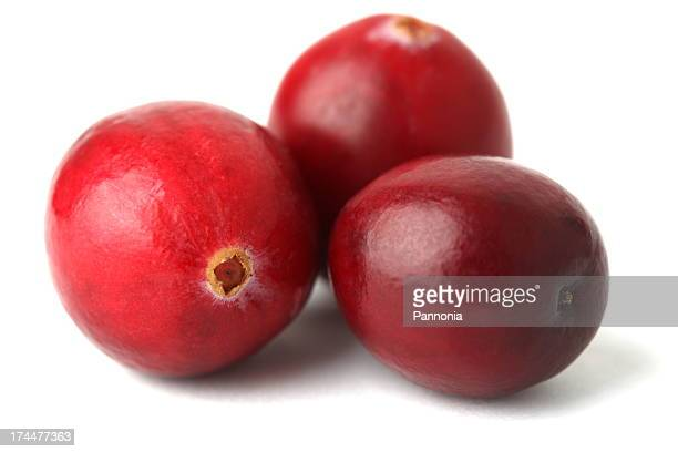 Three cranberries on a white background