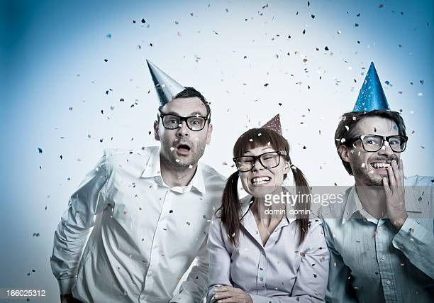 Three crazy Geek people with party hats and confetti, celebrating