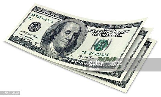 Three crisp, stacked, duo tone one hundred dollar bills