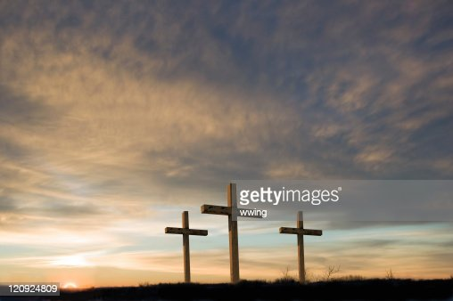 Three crosses on Good Friday with setting sun and  copy.