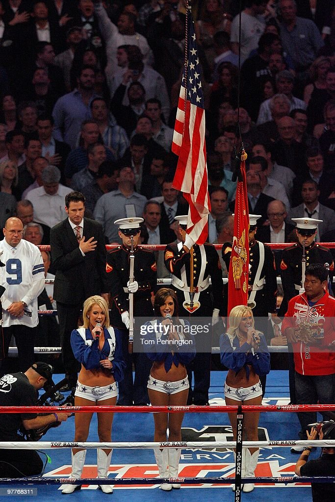 Three Dallas Cowboys cheerleaders sing the United States National Anthem before the fight between Manny Pacquiao of the Philippines and Joshua Clottey of Ghana during the WBO welterweight title fight at Cowboys Stadium on March 13, 2010 in Arlington, Texas.