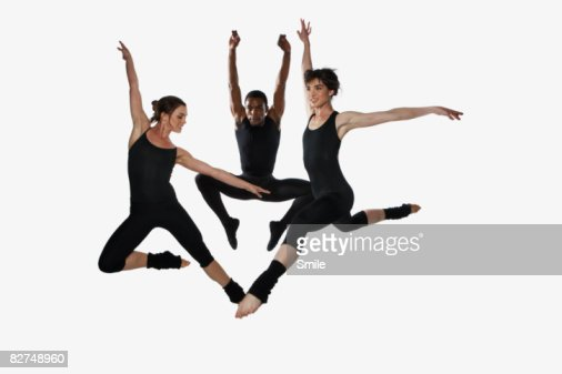 Three dancers jumping in the air : ストックフォト