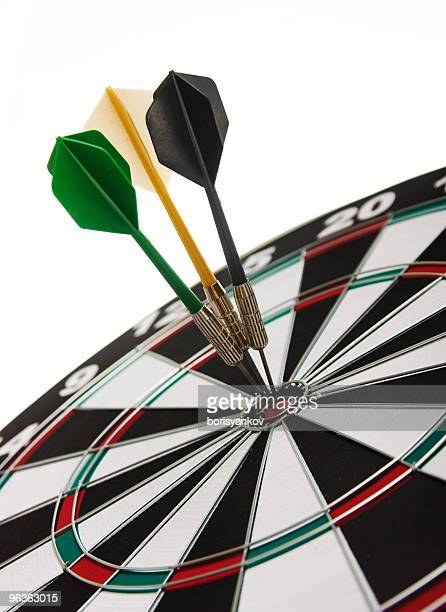 Three darts perfectly on target on a dartboard