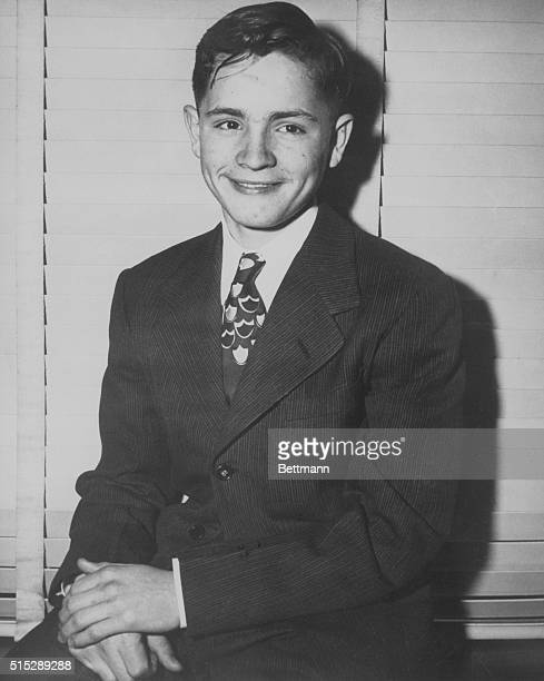 Three days before he ran away from Boy's Town Charles Manson poses in a suit and tie