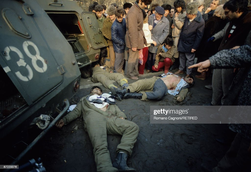 Three dead members of Ceausescu's security team lie in the town centre of Bucharest during the Romanian Revolution, December 1989.