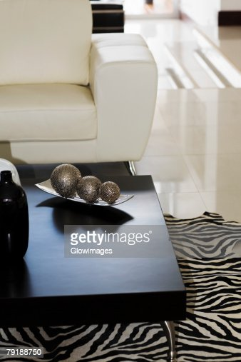 Three decorative balls on a table : Foto de stock